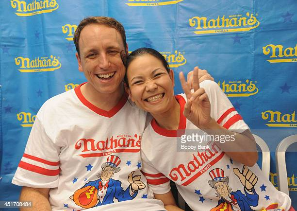 Joey Chestnut and Sonya Thomas at the 2014 Nathan's Famous 4th July International Hot Dog Eating Contest at Coney Island on July 4 2014 in the...