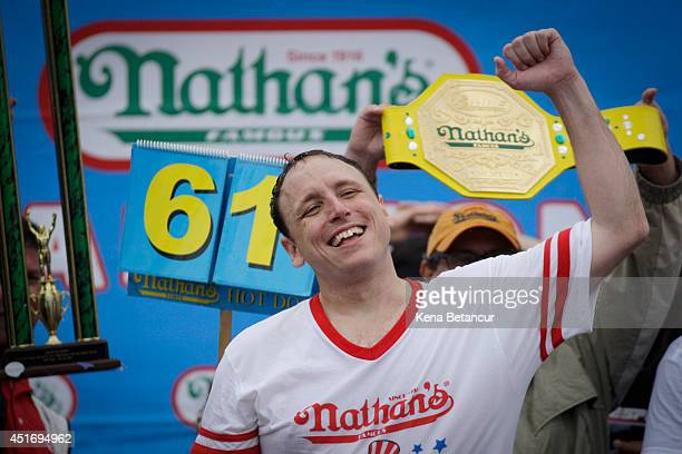 Joey Chestnut celebrates after winning the 98th annual Nathan's Famous Hot Dog Eating Contest at Coney Island on July 4 2014 in the Brooklyn borough...