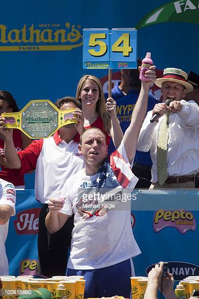 Joey Chestnut celebrates winning the 2010 Nathan's Famous Fourth of July International Hot Dog Eating Contest at the original Nathan's Famous in...