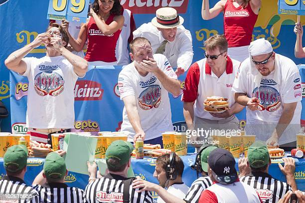 Joey Chestnut competes in the 2010 Nathan's Famous Fourth of July International Hot Dog Eating Contest at the original Nathan's Famous in Coney...