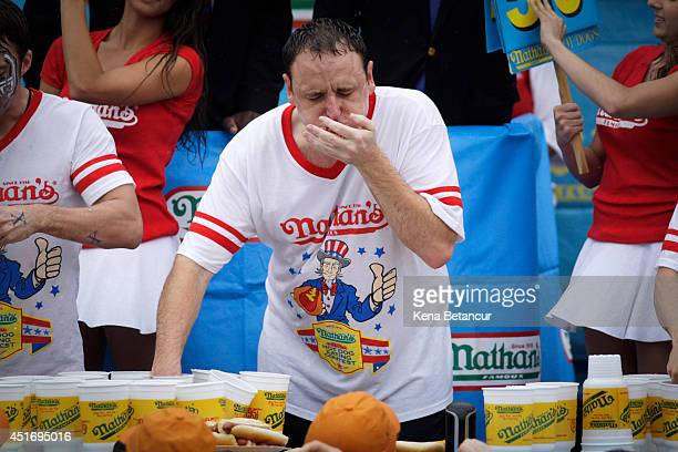 Joey Chestnut competes in the 98th annual Nathan's Famous Hot Dog Eating Contest at Coney Island on July 4 2014 in the Brooklyn borough of New York...