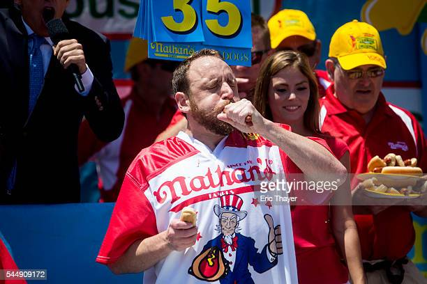 Joey Chestnut competes in the annual Hot Dog Eating Contest at Coney Island July 4 2016 in New York City Joey Chestnut retook the crown eating 70 hot...