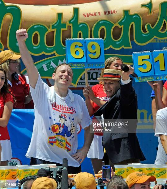 Joey Chestnut eats 69 hot dogs to win the 2013 Nathan's Famous Hot Dog Eating Contest at Coney Island on July 4 2013 in the Brooklyn borough of New...