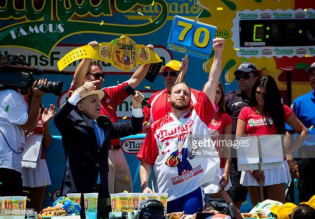Joey Chestnut reacts after winning the annual Hot Dog Eating Contest at Coney Island July 4 2016 in New York City Joey Chestnut retook the crown...