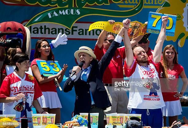Joey Chestnut reacts as Matt Stonie looks on after winning the annual Hot Dog Eating Contest at Coney Island July 4 2016 in New York City Joey...