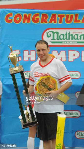 Joey Chestnut wins the Men's Division with 61 Hot Dogs at the 2014 Nathan's Famous 4th July International Hot Dog Eating Contest at Coney Island on...