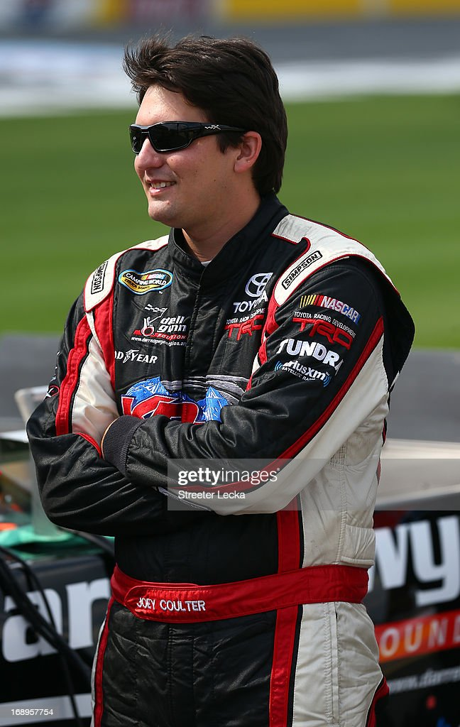 Joey Coulter, driver of the #18 Darrell Gwynn Foundation Toyota, stands on pit road during qualifying for the NASCAR Camping World Truck Series North Carolina Education Lottery 200 at Charlotte Motor Speedway on May 17, 2013 in Concord, North Carolina.