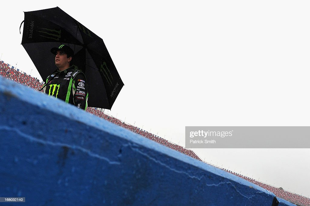 Joey Coulter, driver of the #54 Monster Energy Toyota, walks down pit road as rain delayed the start of the NASCAR Nationwide Series Aaron's 312 at Talladega Superspeedway on May 4, 2013 in Talladega, Alabama.