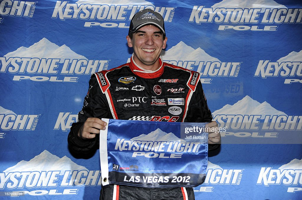 Joey Coulter, driver of the #22 RCR/Darrell Gwynn Foundation Chevrolet, poses with the Keystone Light Pole Award after qualifying in the pole position for the NASCAR Camping World Truck Series Smith's 350 race at Las Vegas Motor Speedway on September 28, 2012 in Las Vegas, Nevada.