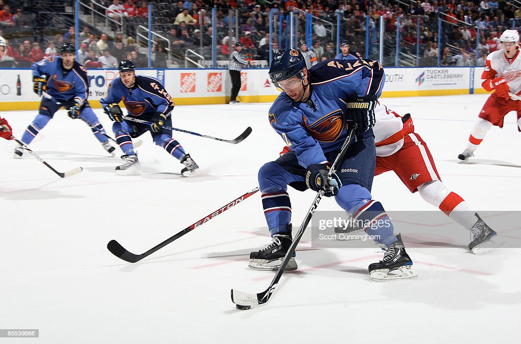 Joey Crabb of the Atlanta Thrashers carries the puck against the Detroit Red Wings at Philips Arena on March 20 2009 in Atlanta Georgia