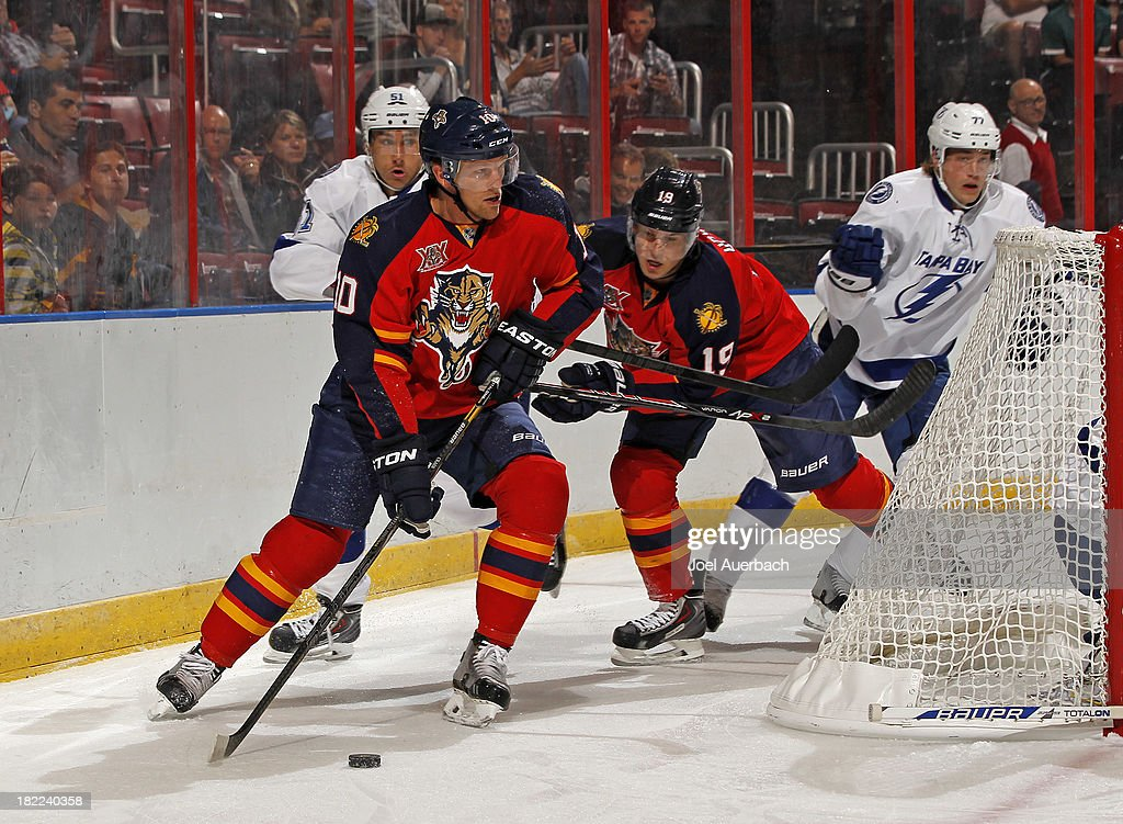 Joey Crabb of the Florida Panthers attempts to pass the puck in front of the Tampa Bay Lightning net at the BBT Center on September 28 2013 in...