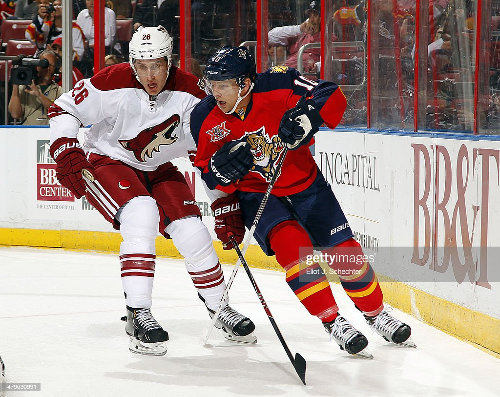 Joey Crabb of the Florida Panthers skates for position against Michael Stone of the Phoenix Coyotes at the BBT Center on March 11 2014 in Sunrise...