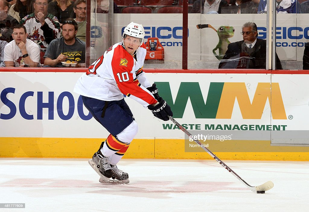 Joey Crabb of the Florida Panthers skates with the puck against the Phoenix Coyotes at Jobingcom Arena on March 20 2014 in Glendale Arizona
