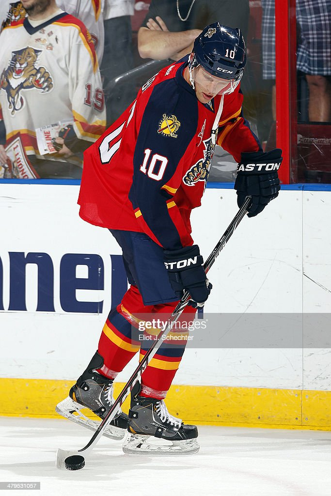 Joey Crabb of the Florida Panthers skates with the puck prior to the start of the game against the Phoenix Coyotes at the BBT Center on March 11 2014...
