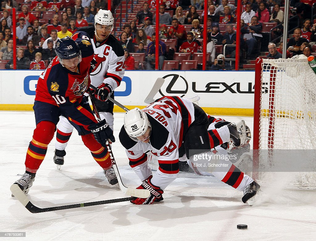 Joey Crabb of the Florida Panthers tangles with Anton Volchenkov of the New Jersey Devils at the BBT Center on March 14 2014 in Sunrise Florida