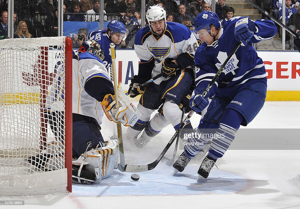 Joey Crabb of the Toronto Maple Leafs is stopped in close by Jaroslav Halak of the St Louis Blues during game action January 6 2011 at the Air Canada...