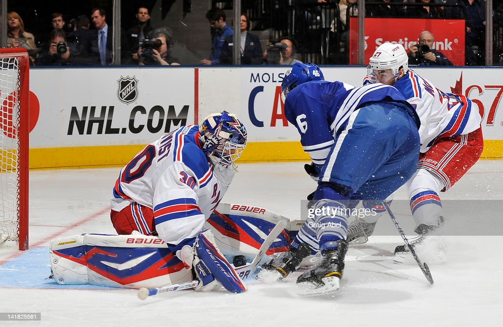 Joey Crabb of the Toronto Maple Leafs scores a second period goal on Henrik Lundqvist of the New York Rangers as Ryan McDonagh defends during NHL...