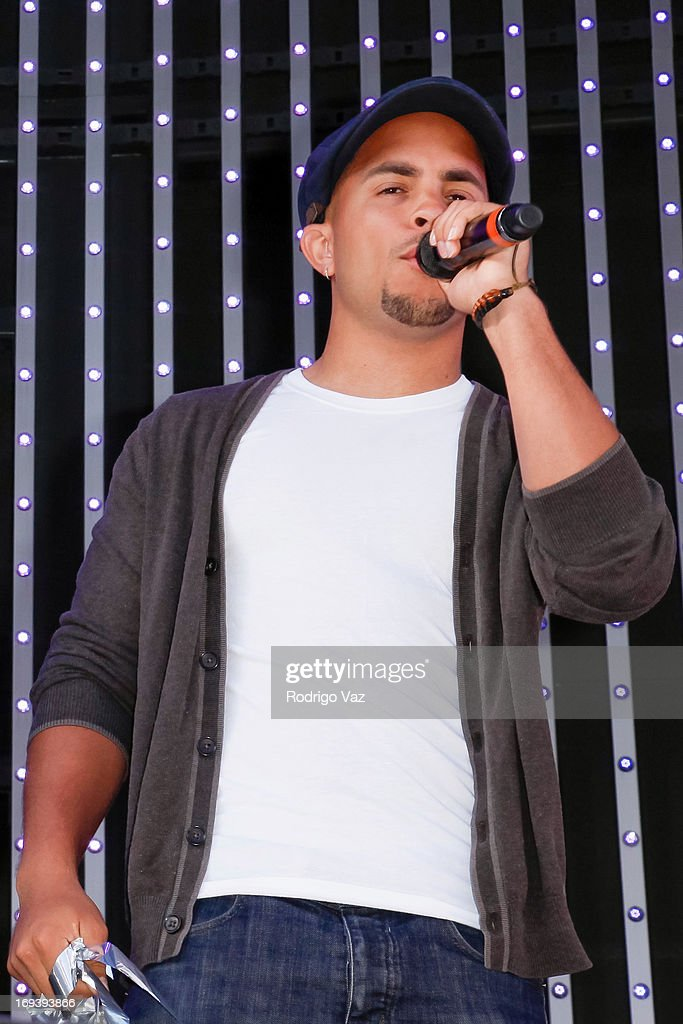 Joey Diggs Jr. of Midnight Red performs at Universal CityWalk 20th Anniversary event featuring 8 original cars from 'Fast & The Furious' Movie Franchise at 5 Towers Outdoor Concert Arena on May 23, 2013 in Universal City, California.