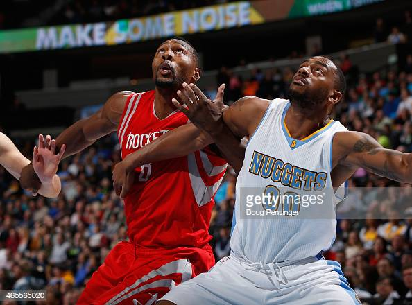 Joey Dorsey of the Houston Rockets and Darrell Arthur of the Denver Nuggets battle for position at Pepsi Center on March 7 2015 in Denver Colorado...