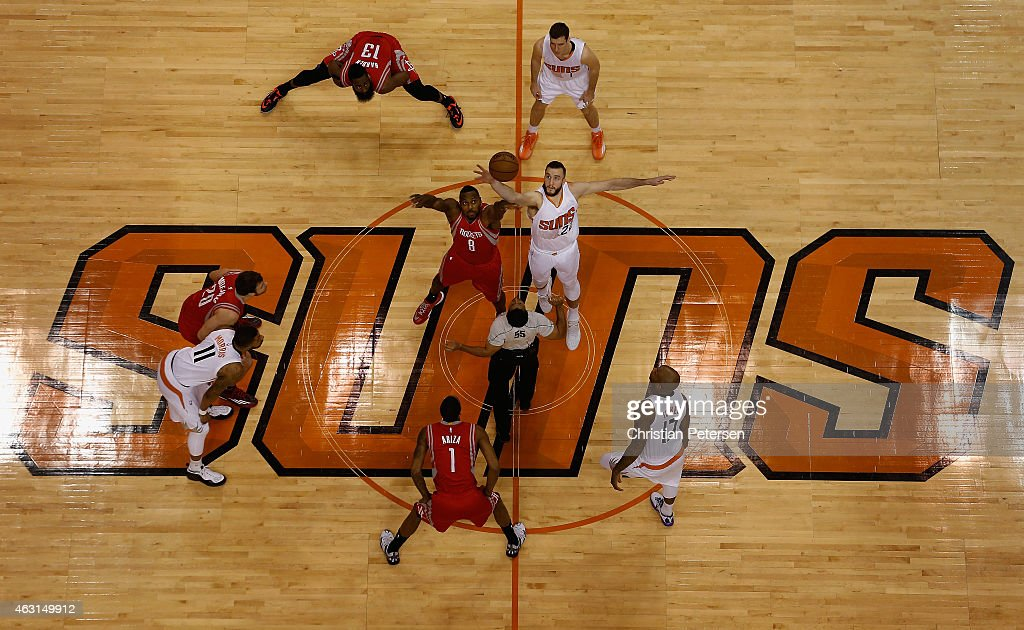 Joey Dorsey #8 of the Houston Rockets and Miles Plumlee #22 of the Phoenix Suns jump for the openning tip off during the NBA game at US Airways Center on February 10, 2015 in Phoenix, Arizona.