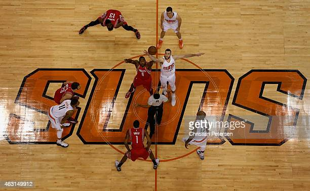 Joey Dorsey of the Houston Rockets and Miles Plumlee of the Phoenix Suns jump for the openning tip off during the NBA game at US Airways Center on...