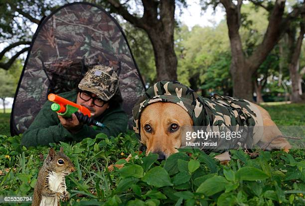 Joey 'Elmer Fudd' Flechas using the Squirrel Buster draws the attention of 'Ardie the Squirrel' as his faithful dog 'Enzo' keeping a low profile...