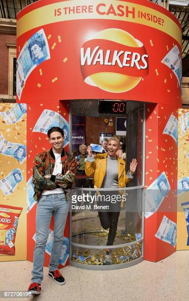Joey Essex and Olivia Buckland take on the Walkers Cash Dash at London's Victoria Station to celebrate Walkers' Pay Packets on April 25 2017 in...