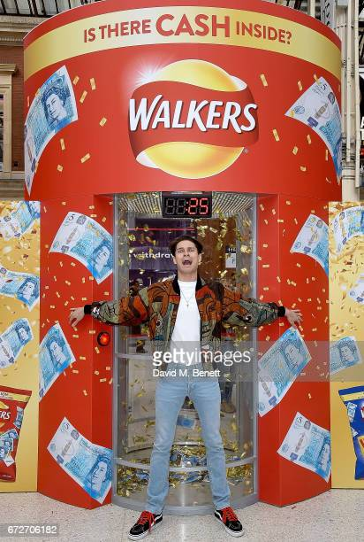 Joey Essex visits the Walkers Cash Dash at London's Victoria Station to celebrate Walkers' Pay Packets on April 25 2017 in London England