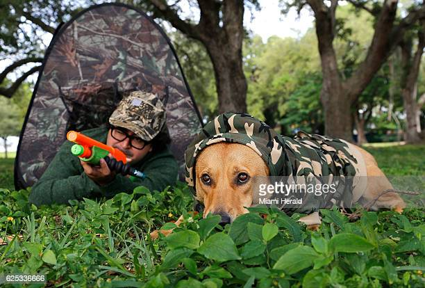 Joey Flechas uses the Squirrel Buster to draw the attention of squirrels as his faithful dog 'Enzo' keeps a low profile using the latest in pet...
