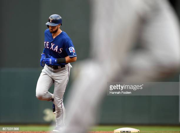 Joey Gallo and Mike Napoli of the Texas Rangers rounds the bases after Gallo hit a tworun home run against the Minnesota Twins during the first...