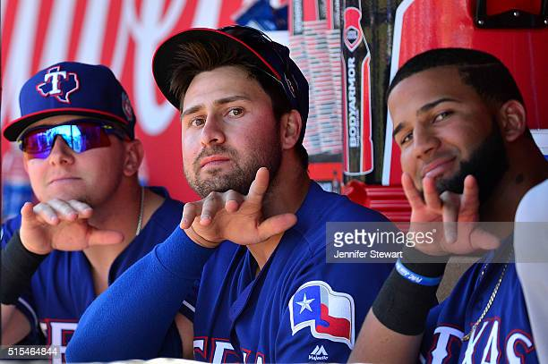 Joey Gallo and Nomar Mazara of the Texas Rangers of the Texas Rangers gesture to the camera during the spring training game against the Los Angeles...