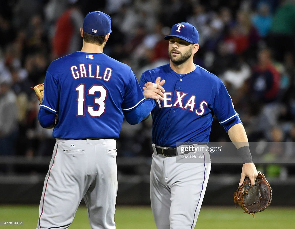 Joey Gallo #13 of the Texas Rangers and Mitch Moreland #18 celebrate their win on June 19, 2015 at U. S. Cellular Field in Chicago, Illinois. The Rangers defeated the White Sox 2-1.