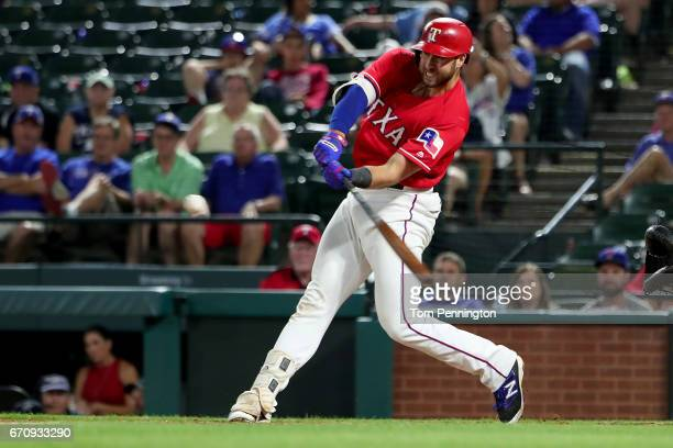 Joey Gallo of the Texas Rangers hits a double against the Kansas City Royals in the bottom of the 13th inning at Globe Life Park in Arlington on...