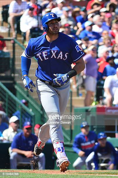 Joey Gallo of the Texas Rangers hits a solo home run in the second inning during the spring training game against the Los Angeles Angels at Tempe...