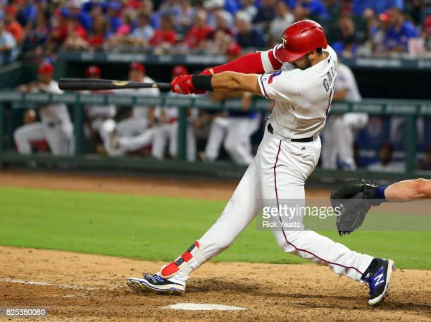 Joey Gallo of the Texas Rangers hits a three run home run in the sixth inning against the Seattle Mariners at Globe Life Park in Arlington on August...