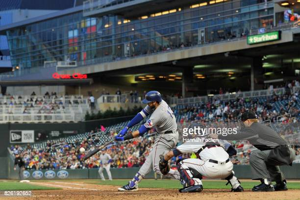 Joey Gallo of the Texas Rangers hits a threerunahome run as Jason Castro of the Minnesota Twins catches during the fourth inning of the game on...