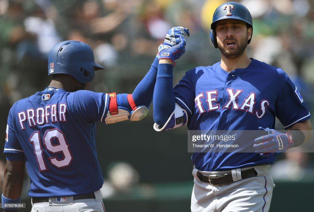 Joey Gallo #13 of the Texas Rangers is congratulated by teammate Jurickson Profar on his solo home run against the Oakland Athletics in the top of the fifth inning at Oakland Alameda Coliseum on April 19, 2017 in Oakland, California.
