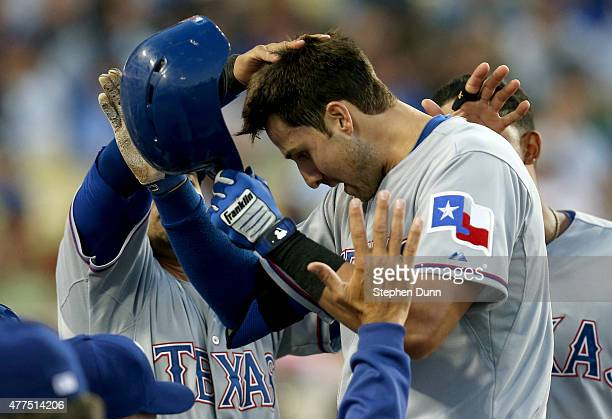 Joey Gallo of the Texas Rangers is greeted as he returns to the dugout after hitting a two run home run in the third inning against the Los Angeles...