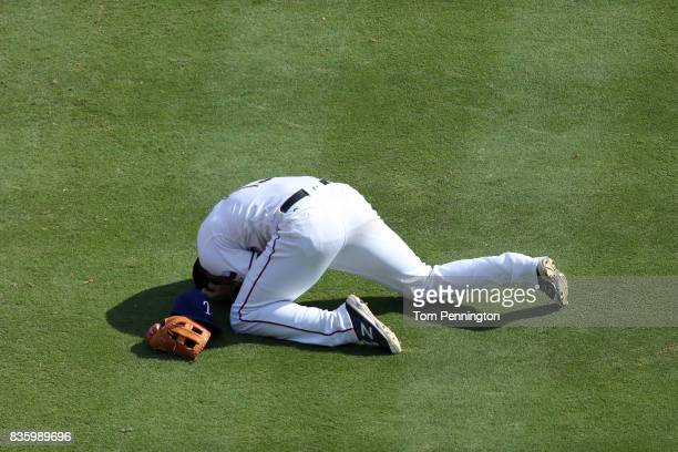 Joey Gallo of the Texas Rangers lays on the field after colliding with Matt Bush of the Texas Rangers while fielding the ball against the Chicago...