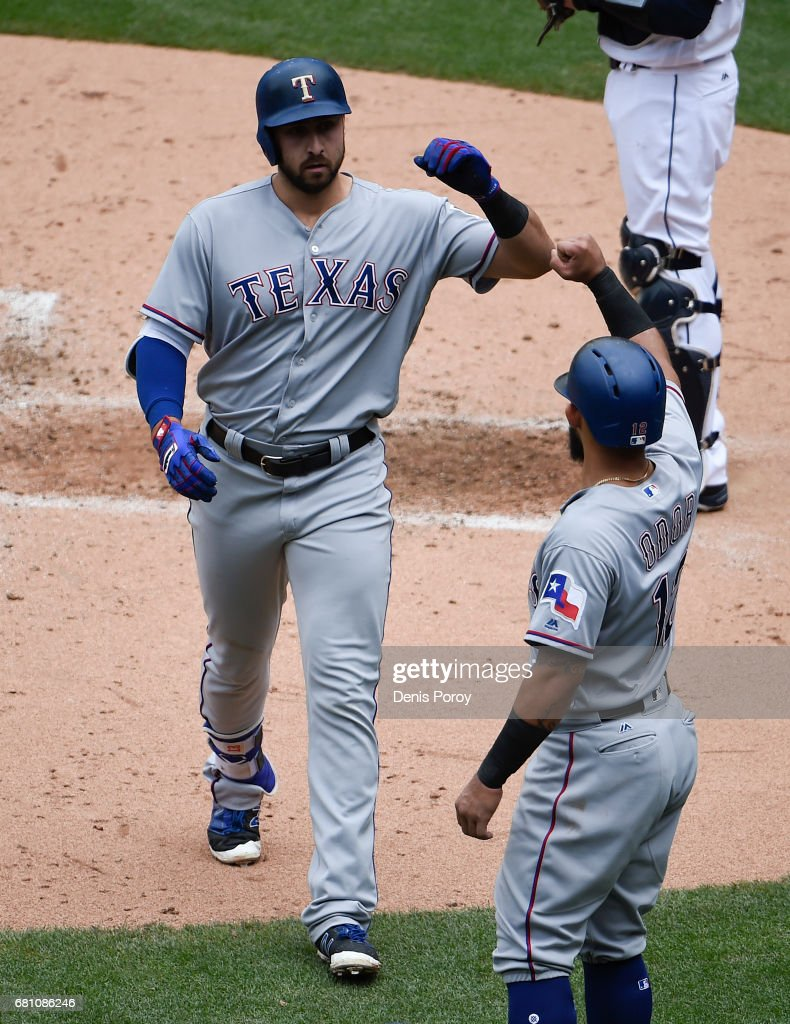Joey Gallo #13 of the Texas Rangers, left, is congratulated by Rougned Odor #12 after hitting a two-run home run during the third inning of a baseball game against the San Diego Padres at PETCO Park on May 9, 2017 in San Diego, California.