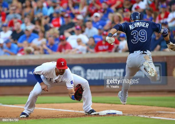 Joey Gallo of the Texas Rangers makes the out in the third inning against Kevin Kiermaier of the Tampa Bay Rays at Globe Life Park in Arlington on...