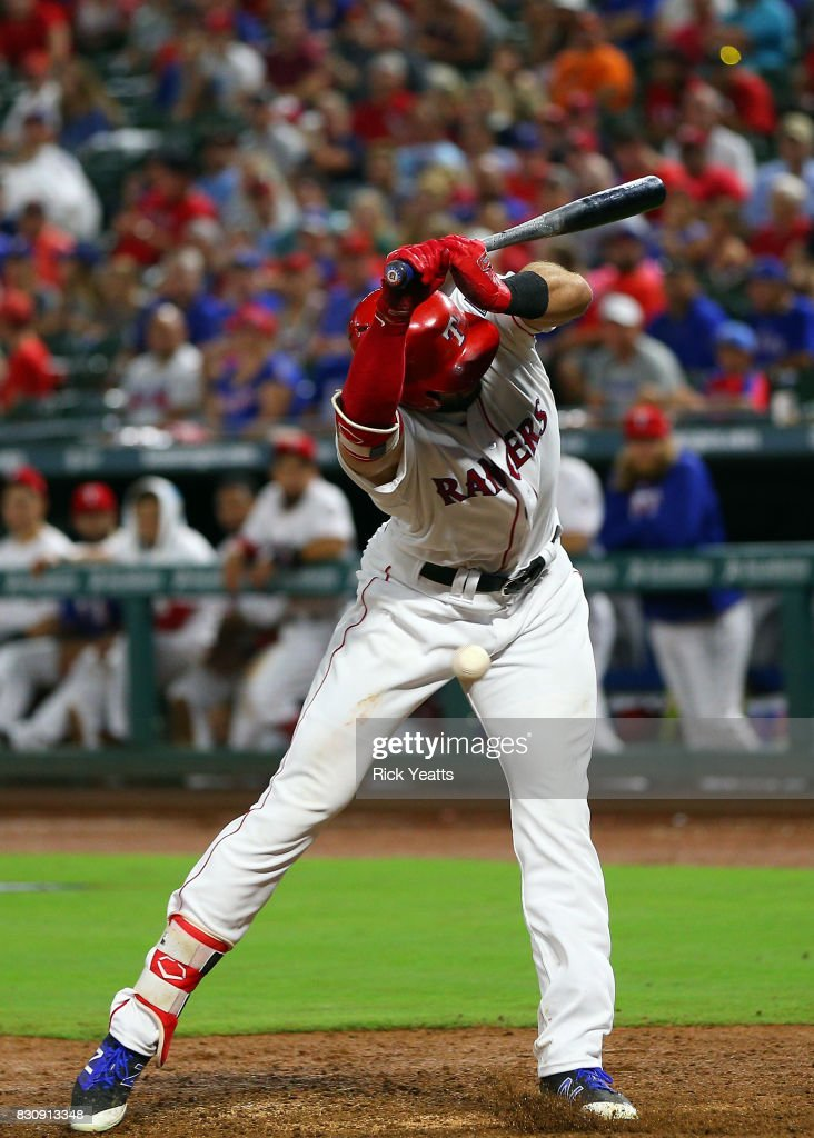 Joey Gallo #13 of the Texas Rangers reacts after being hit with a pitch in the fifth inning against the Houston Astros at Globe Life Park in Arlington on August 12, 2017 in Arlington, Texas.