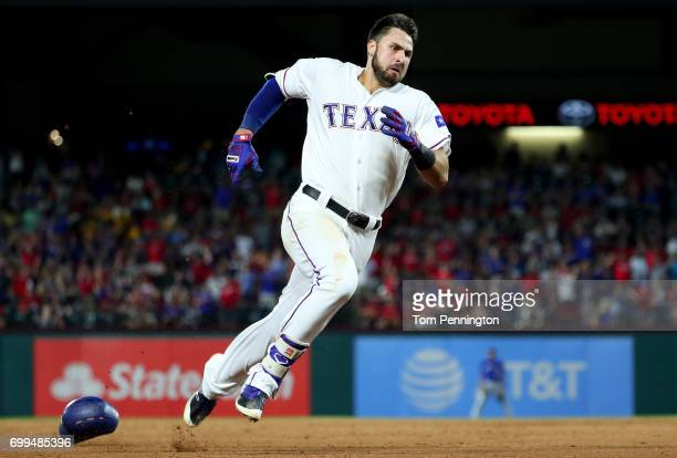 Joey Gallo of the Texas Rangers rounds third base after hitting an insidethepark home run against the Toronto Blue Jays in the bottom of the fifth...