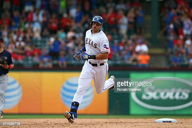Joey Gallo of the Texas Rangers runs the bases after hitting a homerun in the fourth inning against the Minnesota Twins at Globe Life Park in...