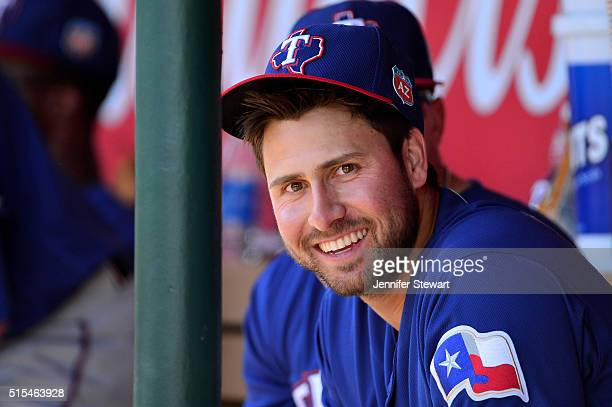 Joey Gallo of the Texas Rangers smiles in the dugout during the spring training game against the Los Angeles Angels at Tempe Diablo Stadium on March...