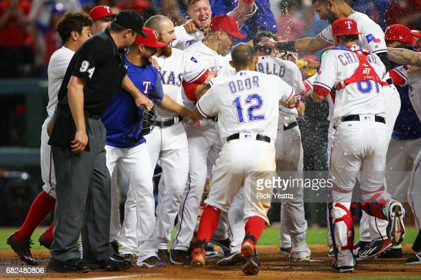 Joey Gallo of the Texas Rangers teammates celebrates Gallo three run walk off home run in the ninth inning against the Oakland Athletics at Globe...