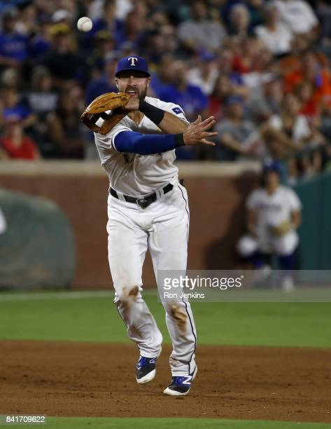 Joey Gallo of the Texas Rangers throws out CJ Cron of the Los Angeles Angels of Anaheim during the fifth inning at Globe Life Park in Arlington on...