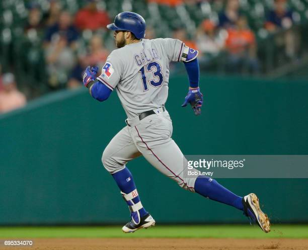 Joey Gallo of the Texas Rangers triples in the second inning against the Houston Astros at Minute Maid Park on June 12 2017 in Houston Texas