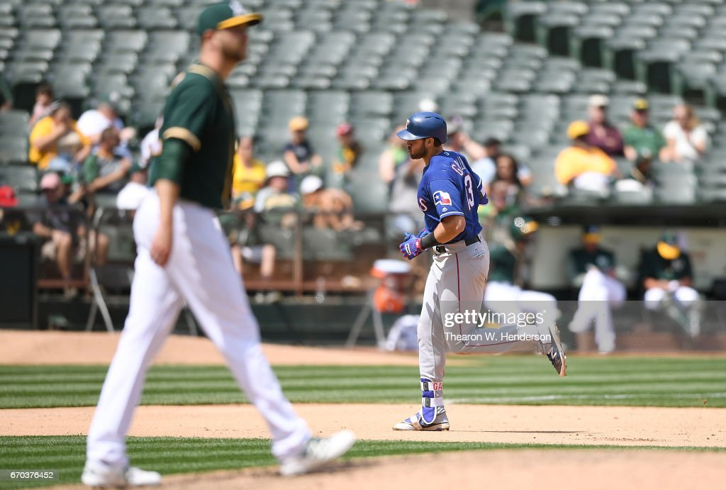 Joey Gallo #13 of the Texas Rangers trots around the bases after hitting a solo home run off of Jesse Hahn #32 of the Oakland Athletics in the top of the fifth inning at Oakland Alameda Coliseum on April 19, 2017 in Oakland, California.