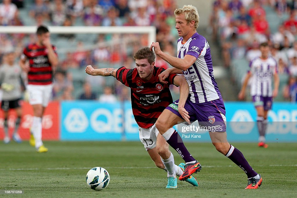Joey Gibbs of the Wanderers and Bas Van Den Brink of the Glory contest for the ball during the round 13 A-League match between the Perth Glory and the Western Sydney Wanderers at Patersons Stadium on December 27, 2012 in Perth, Australia.
